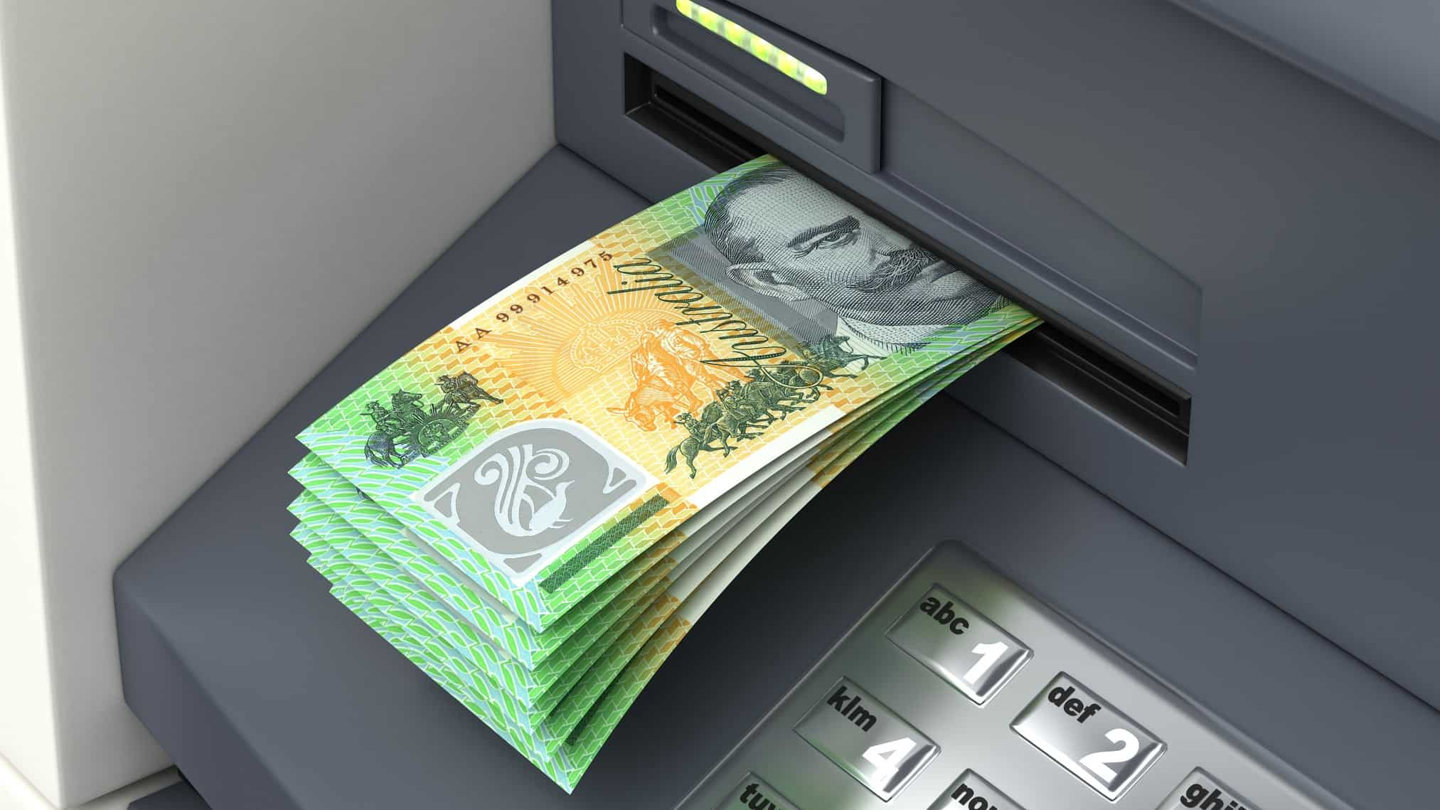 ASX dividend shares represented by ATM delivering wad of $100 notes