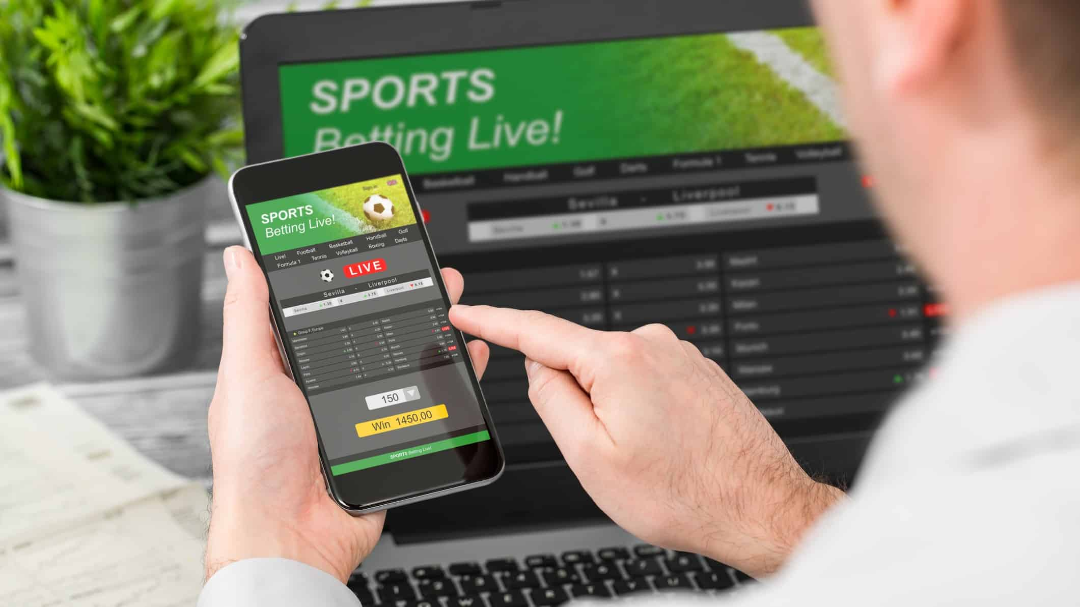 man placing sports bet on mobile phone and laptop, sports betting, pointsbet share price