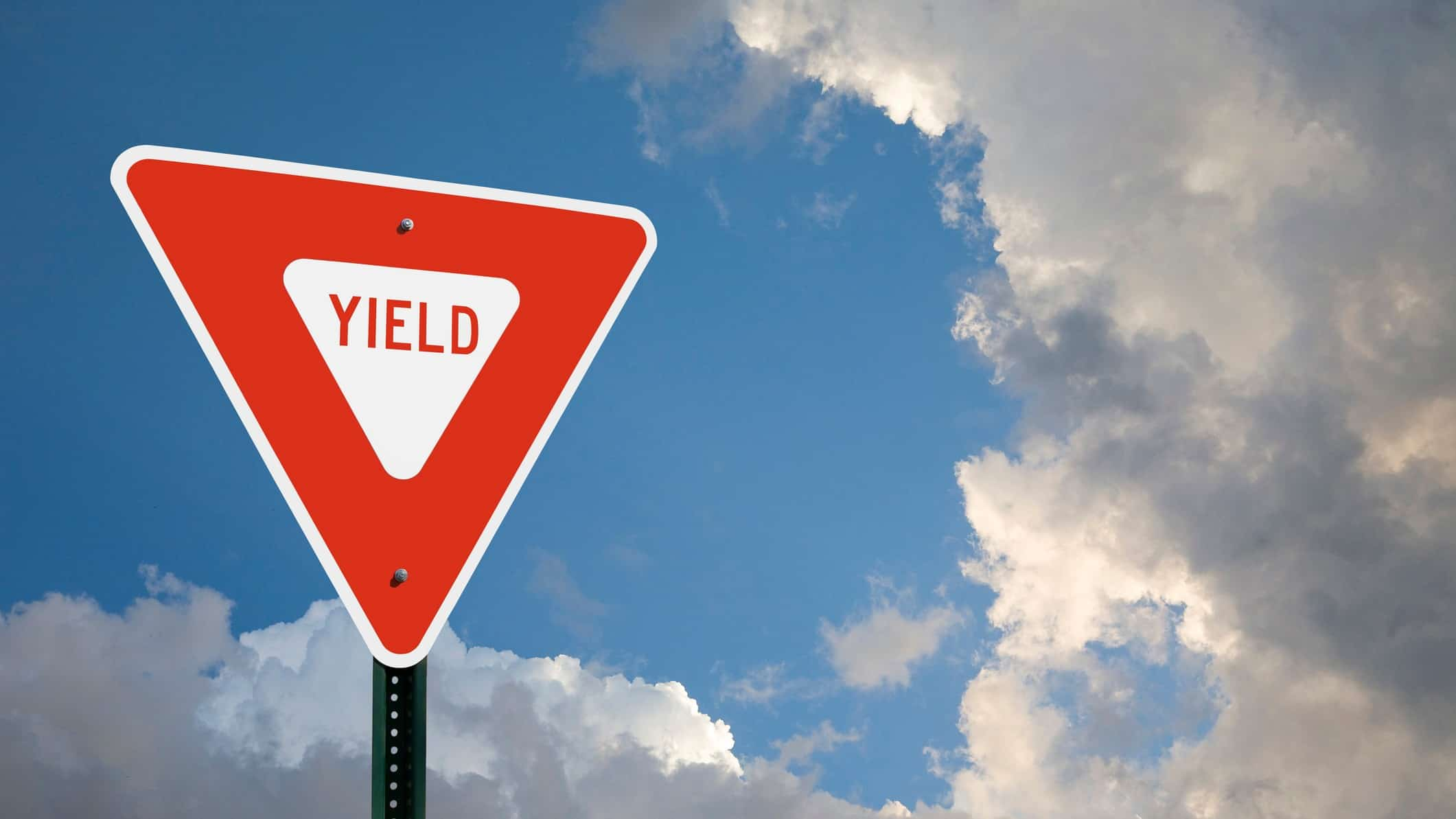 asx shares dividend yield represented by street sign saying the word yield.