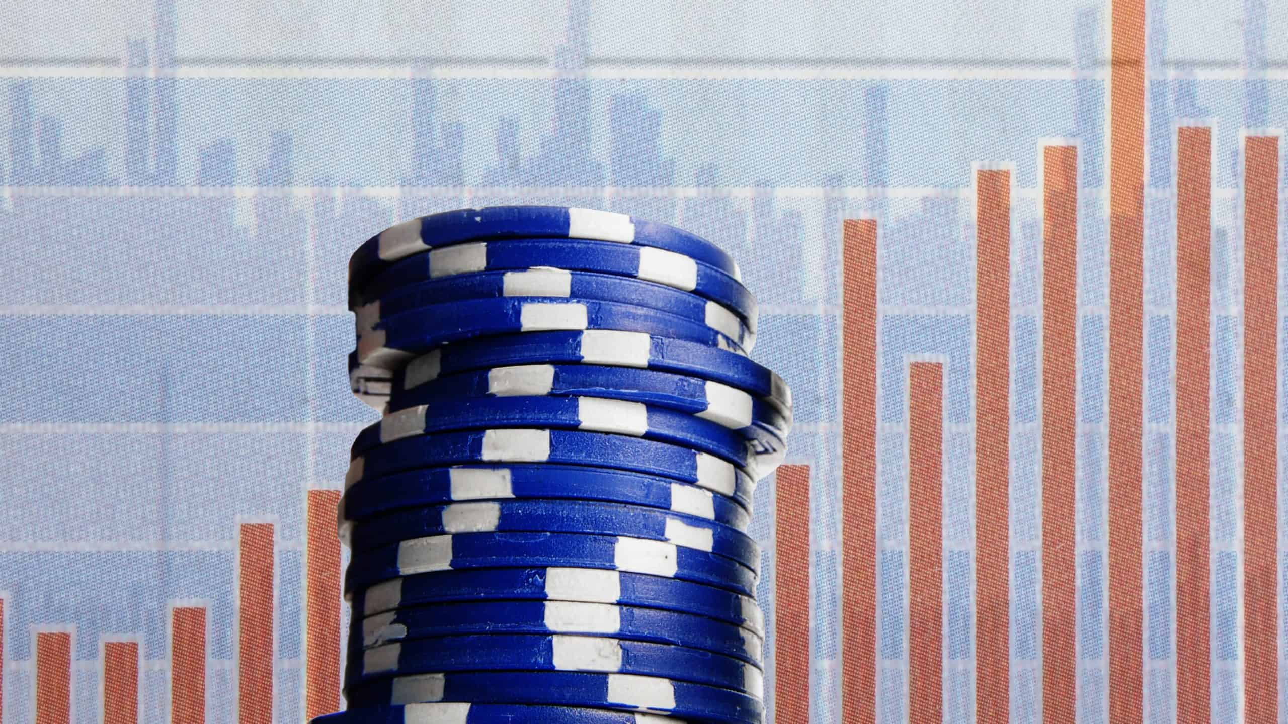 asx blue chip shares represented by pile of blue casino chips in front of bar graph