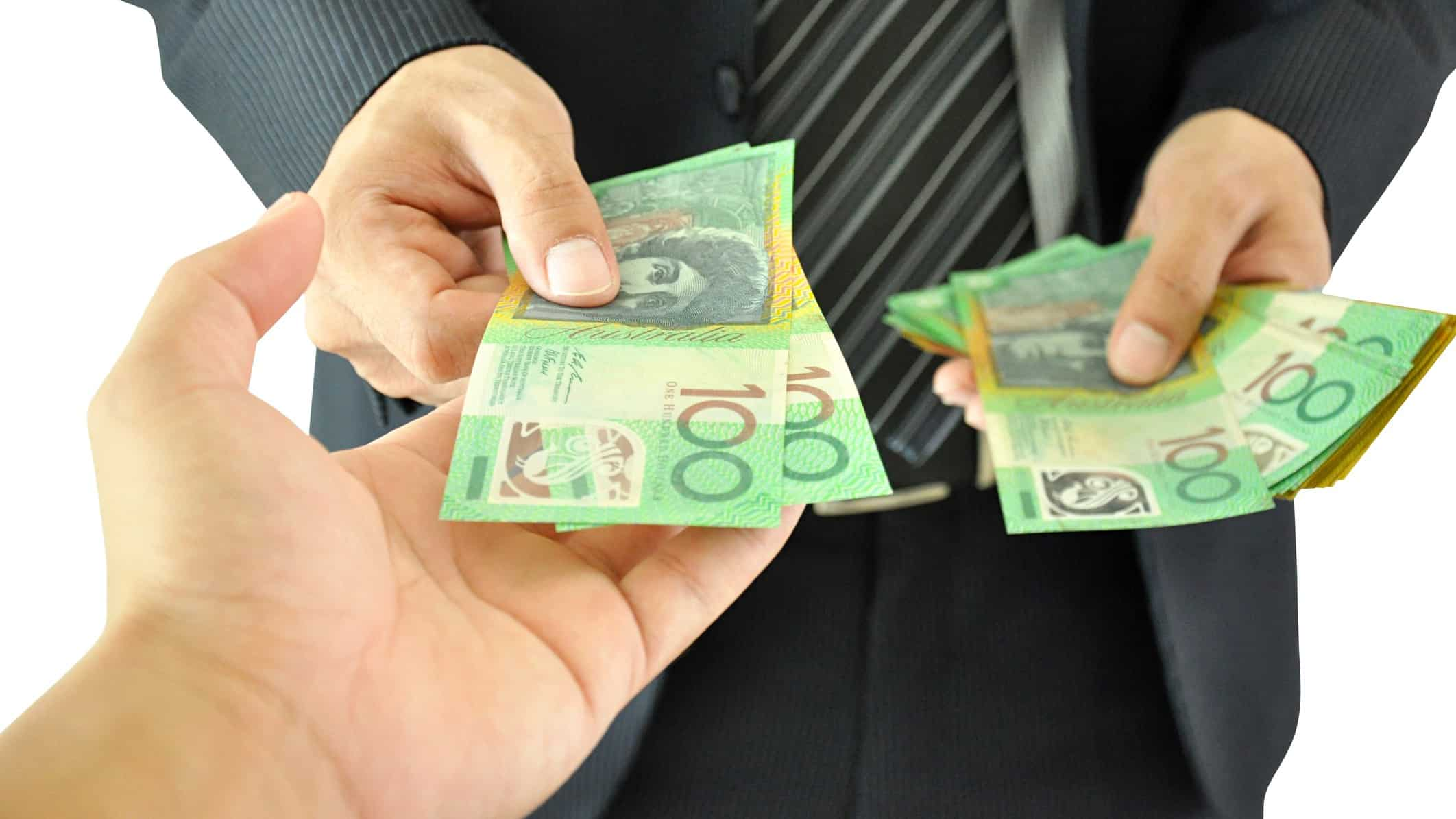 Man handing over cash to another, first investment, asx shares