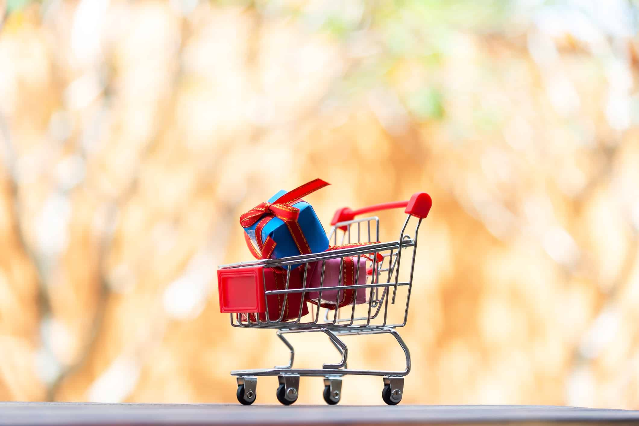 miniature shopping trolley containing gifts
