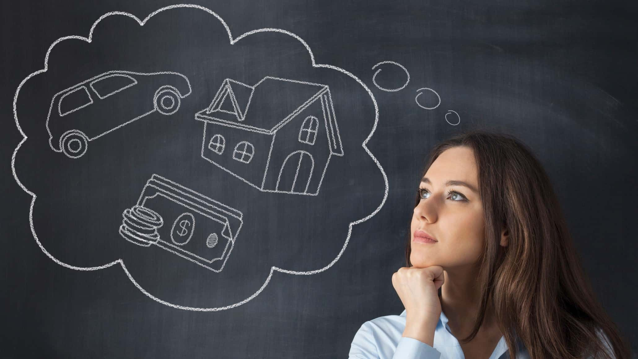 woman standing in front of blackboard with thought bubble containing car, house and money