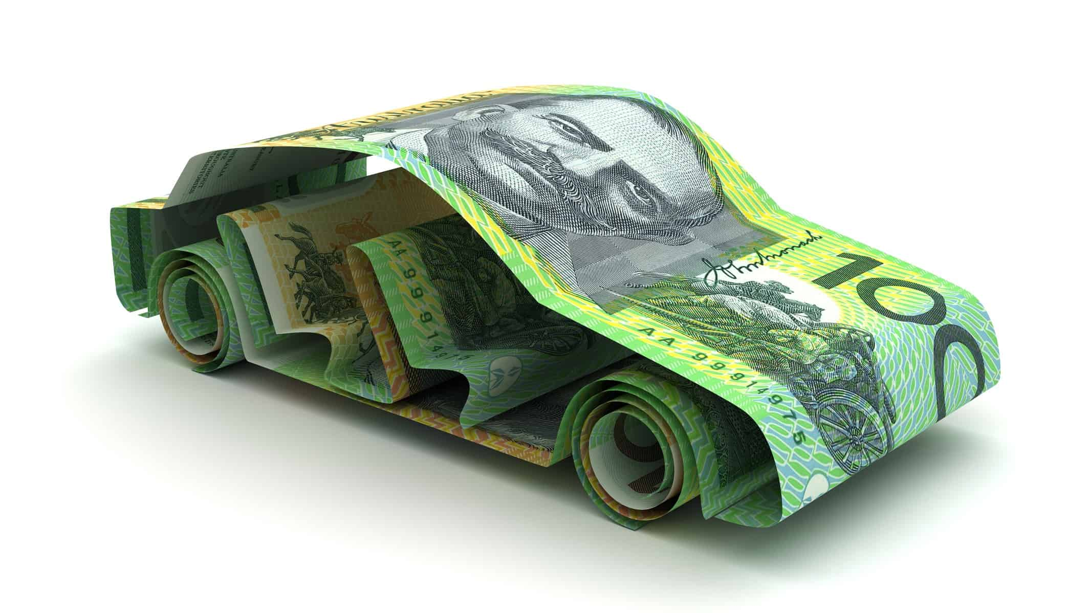 australian one hundred dollar notes formed in the shape of a car representing tesla shares