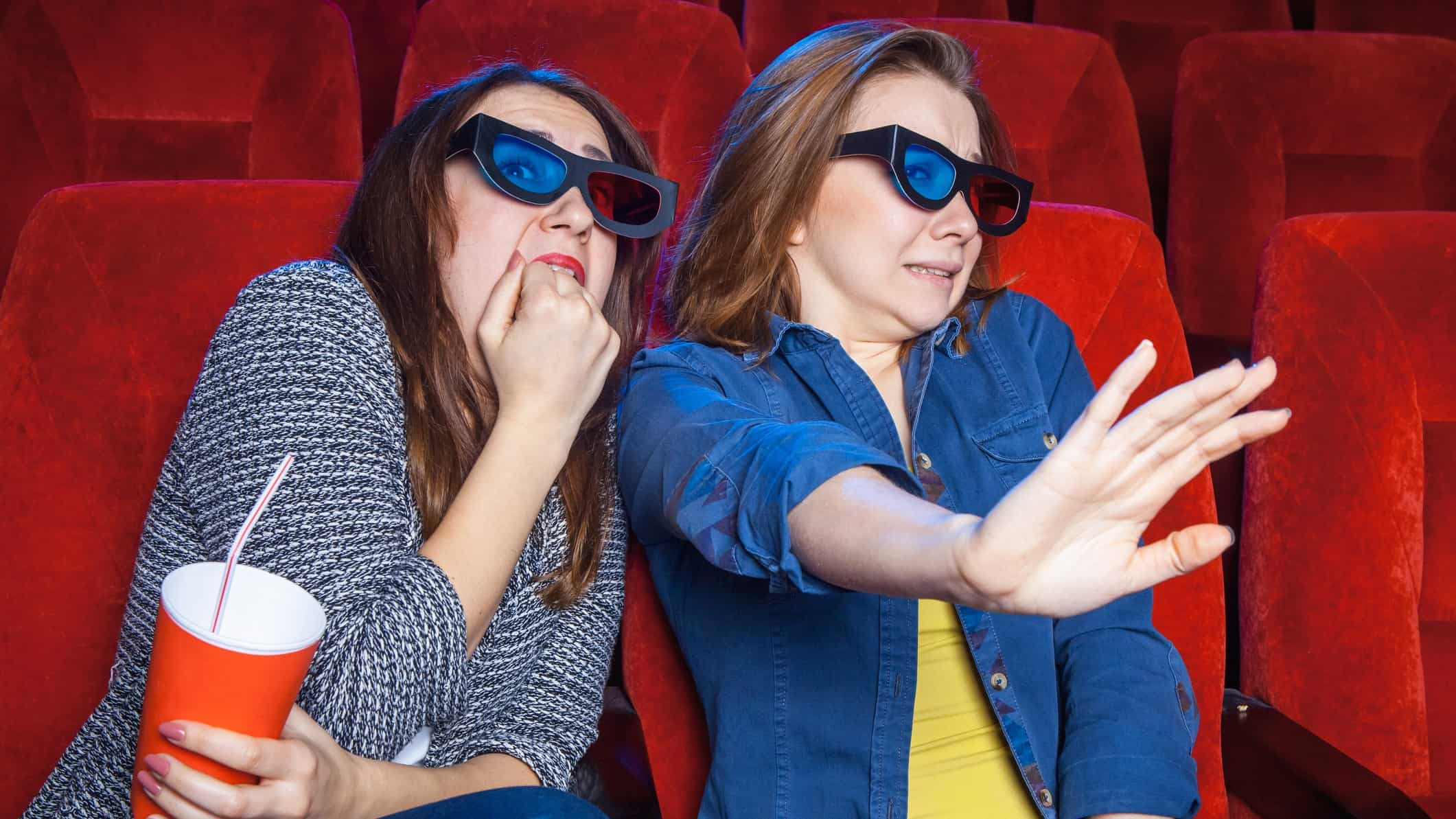 village share price lower represented by two women in cinema looking scared