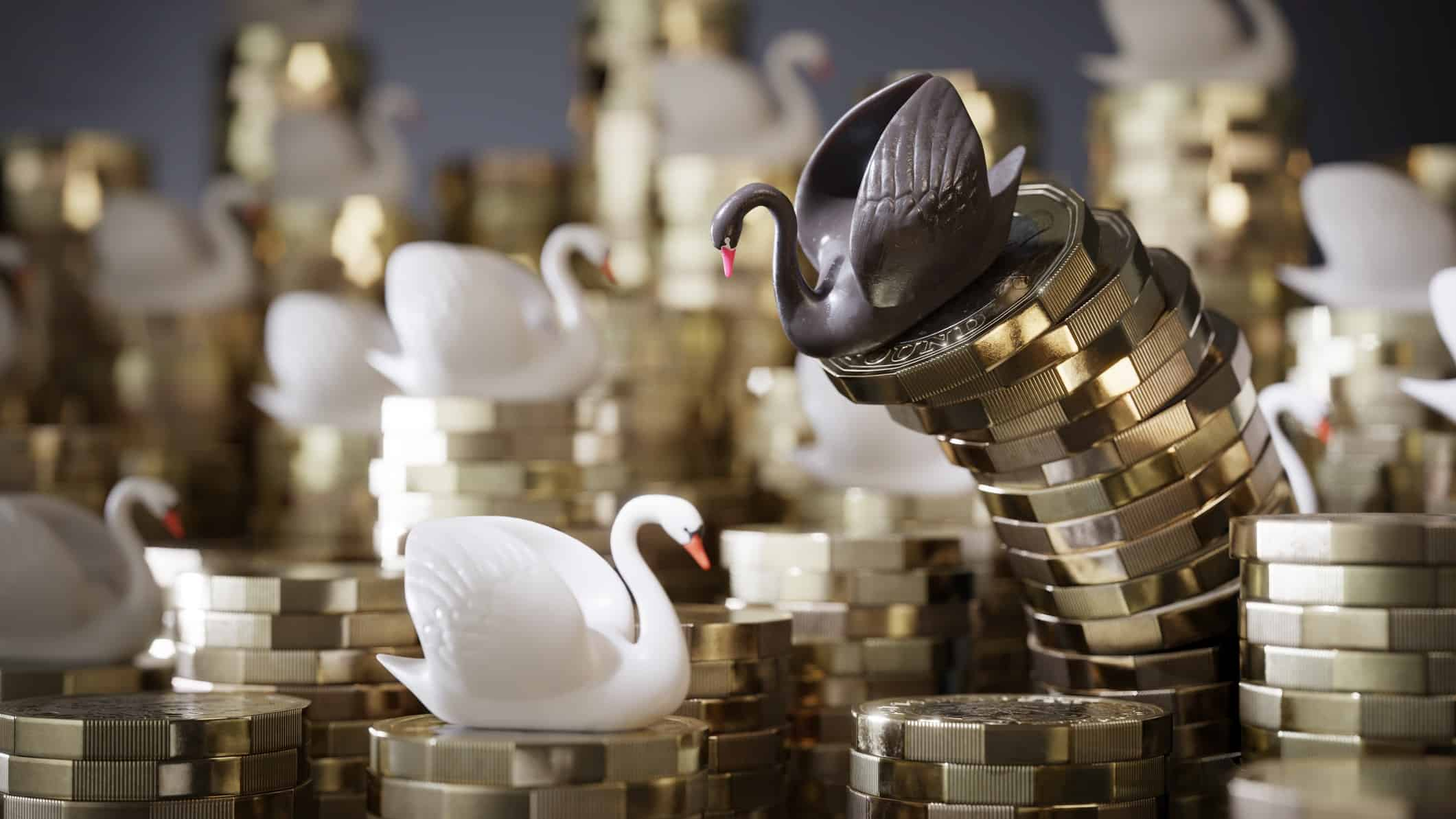 Black swan figurine on top of pile of coins started to topple over