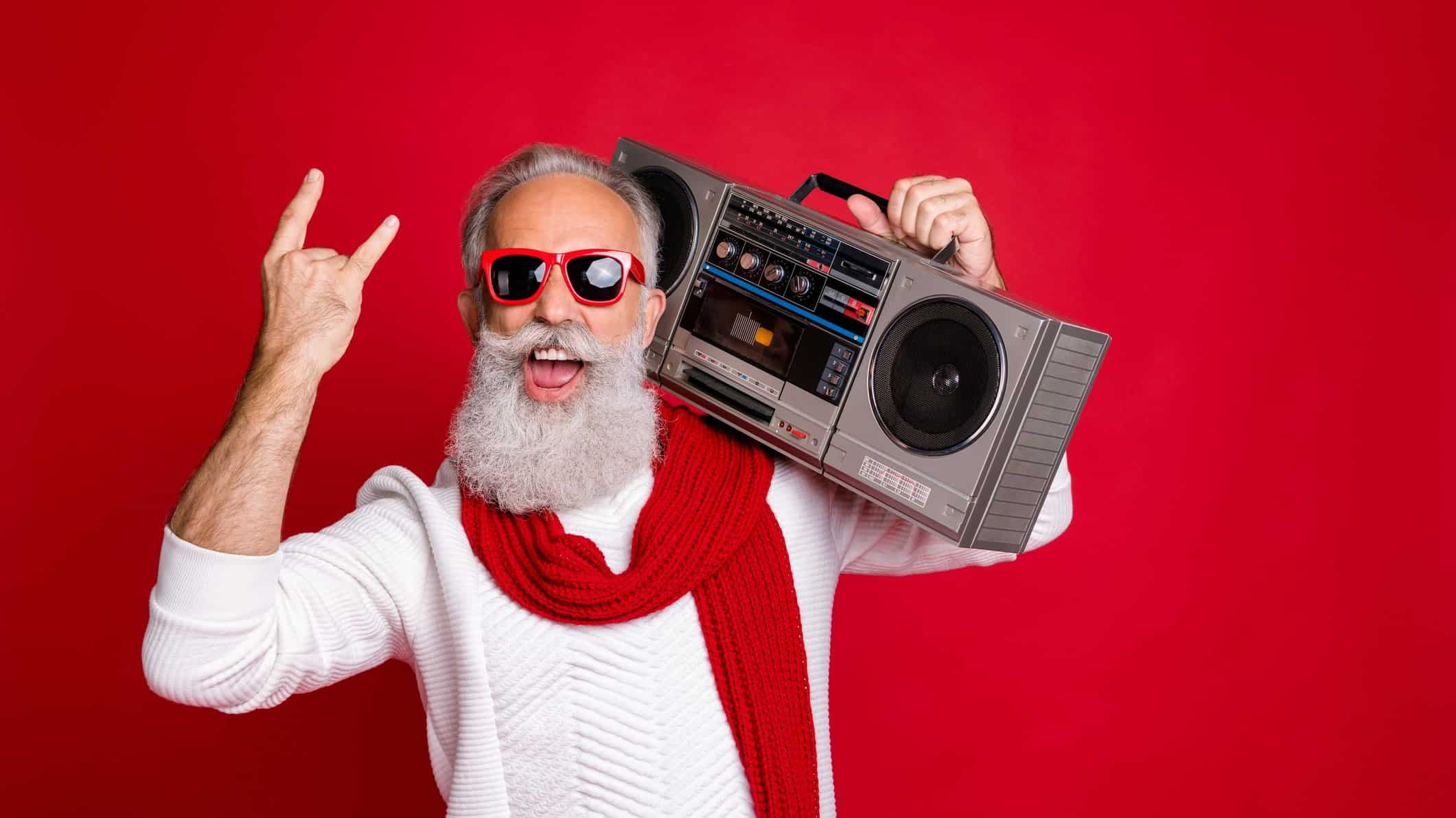 A cool older dude with a long grey beard holds a hi-fi stereo on his shoulder.