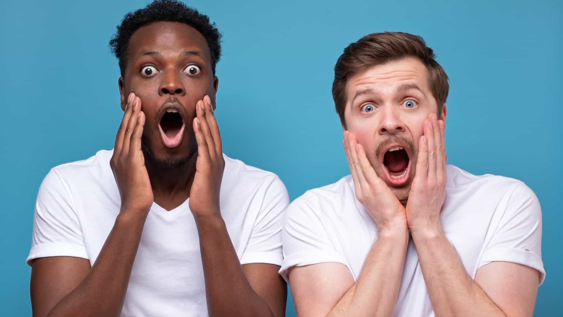 Two men react in shock at Evolution share price drop record profit