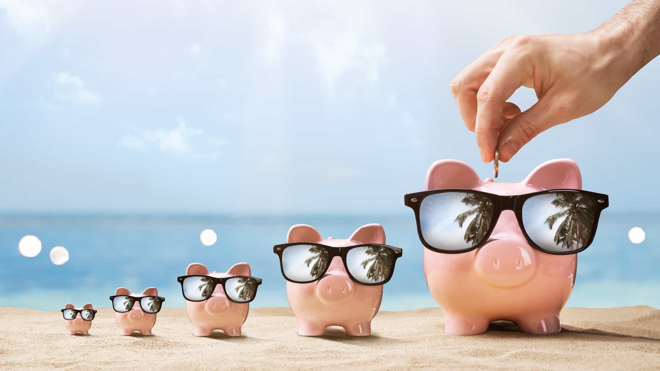 using asx shares to retire represented by piggy bank on sunny beach