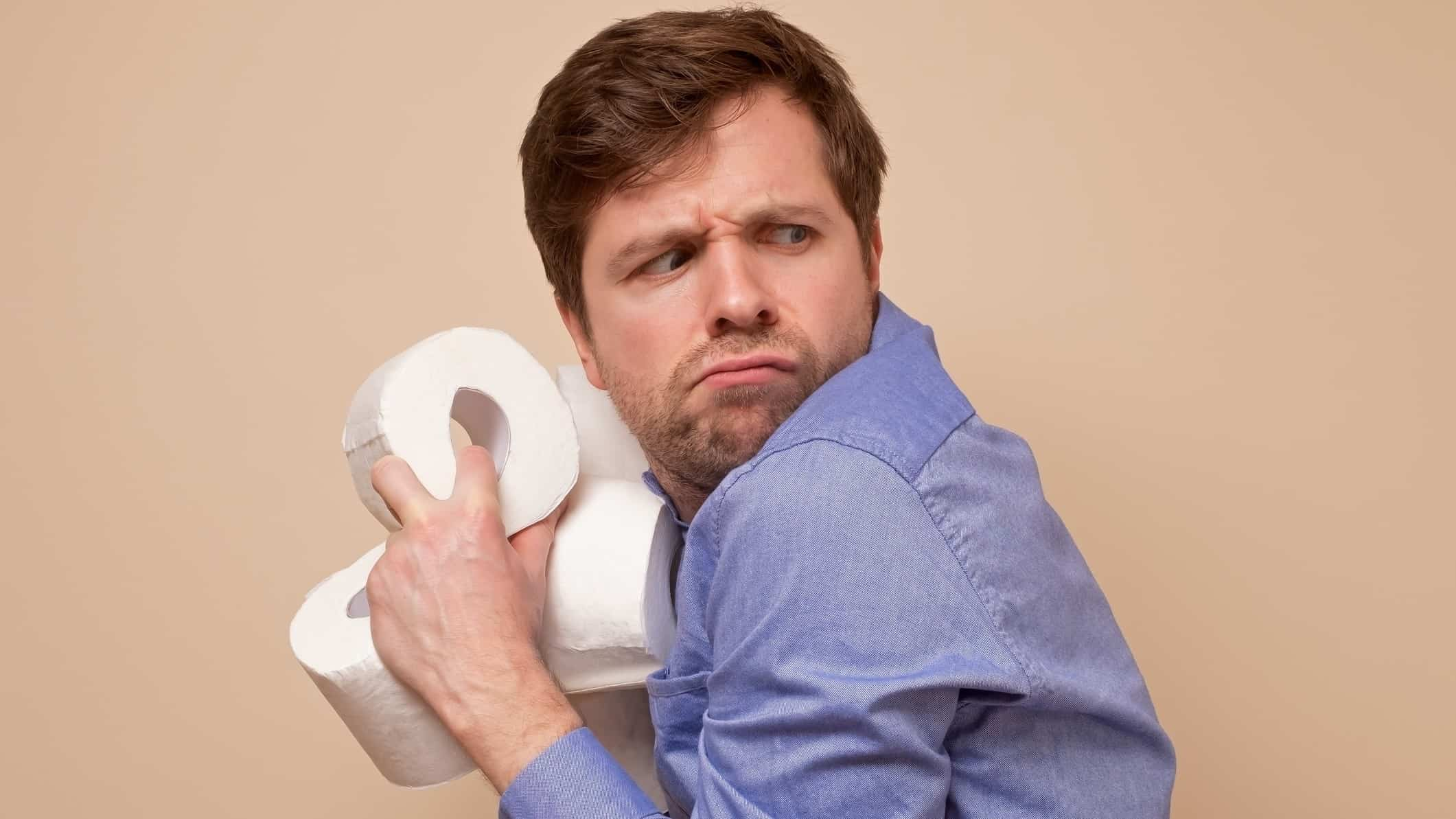 toilet paper asx share price represented by man clutching rolls of toilet paper close to his chest