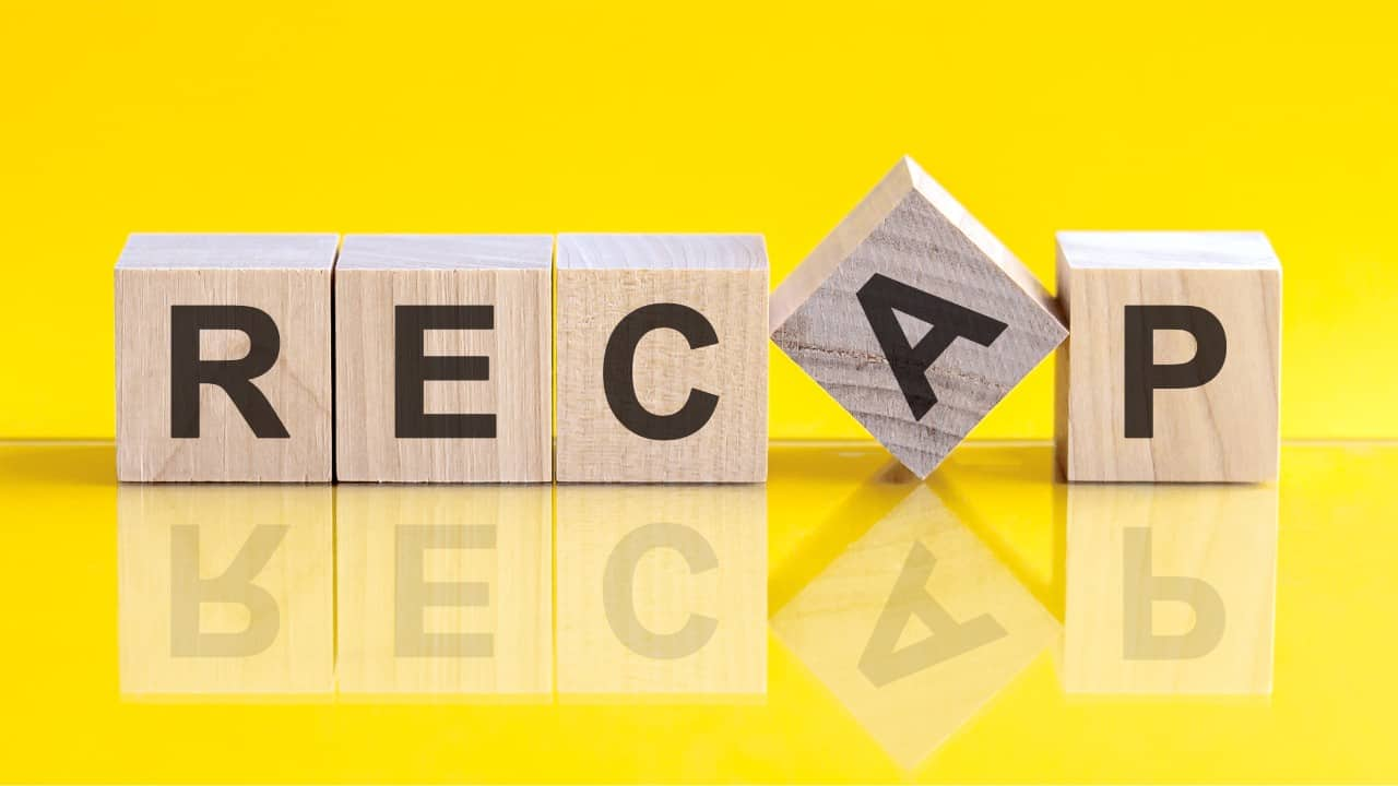 Wooden block letters spelling 'Recap' on a yellow background