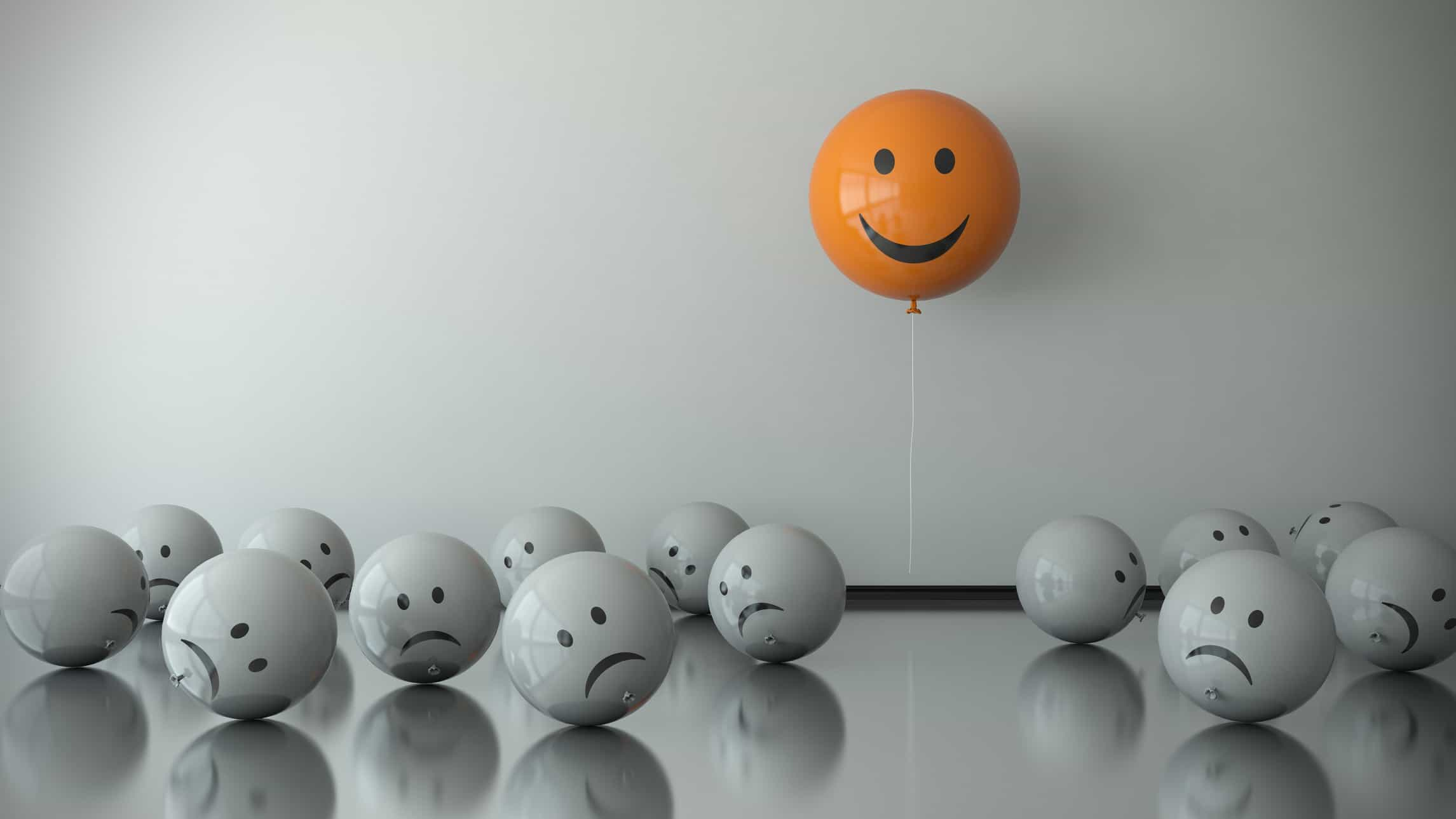 party of asx shares represented by happy orange balloon floating above sad grey balloons