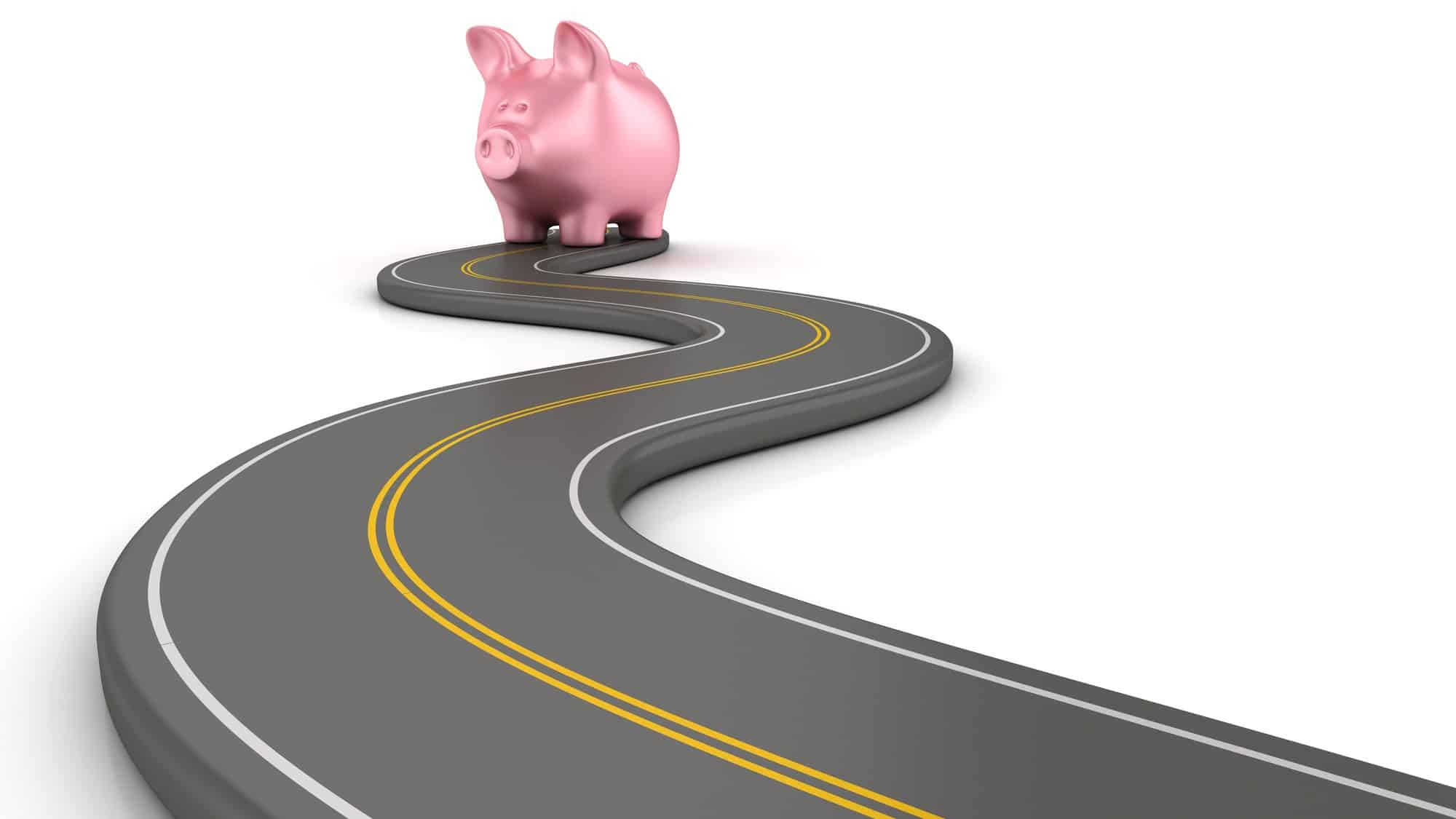 asx share price represented by piggy bank at end of winding road