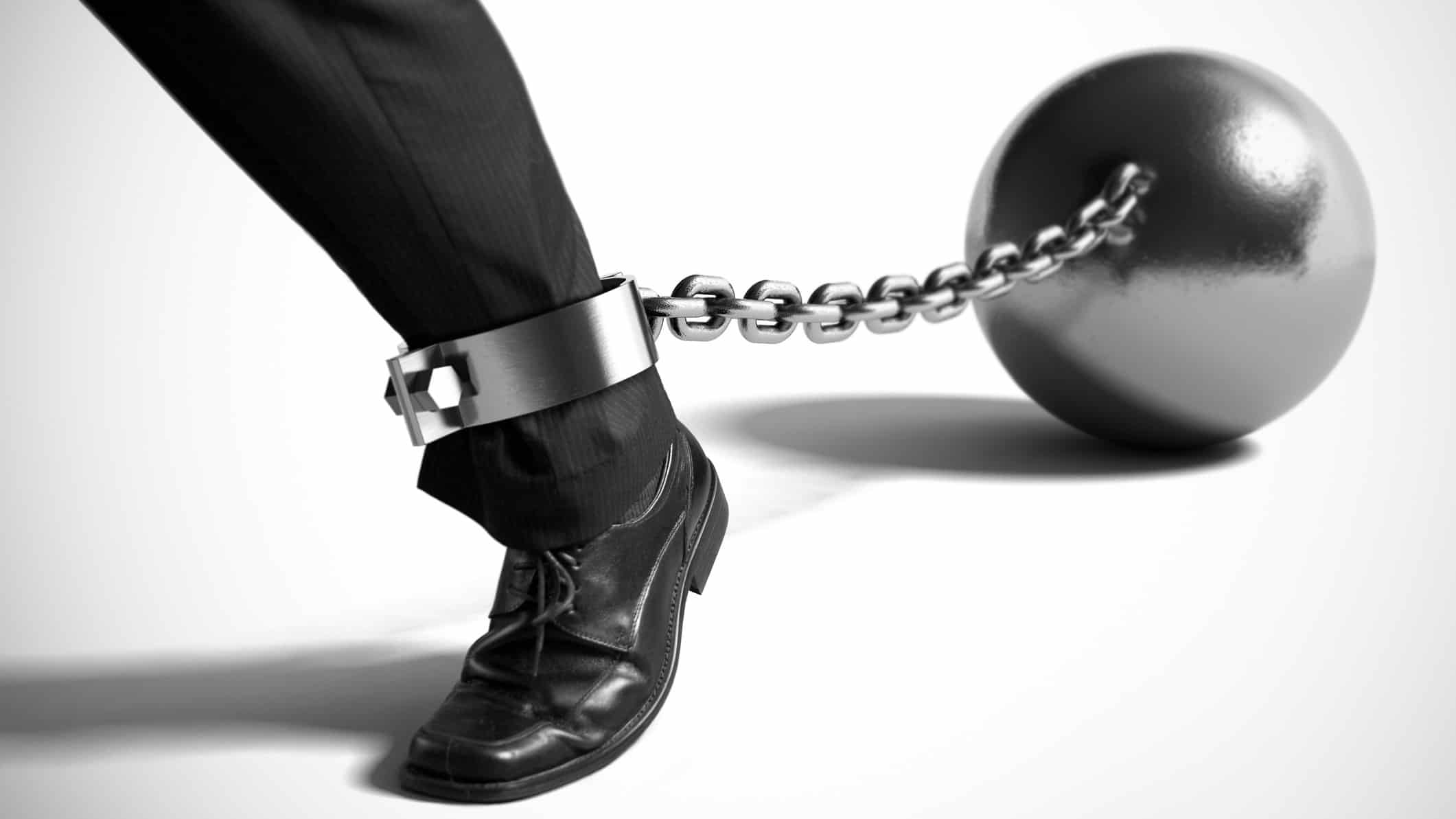 falling asx share price represented by invor's leg with ball and chain attached