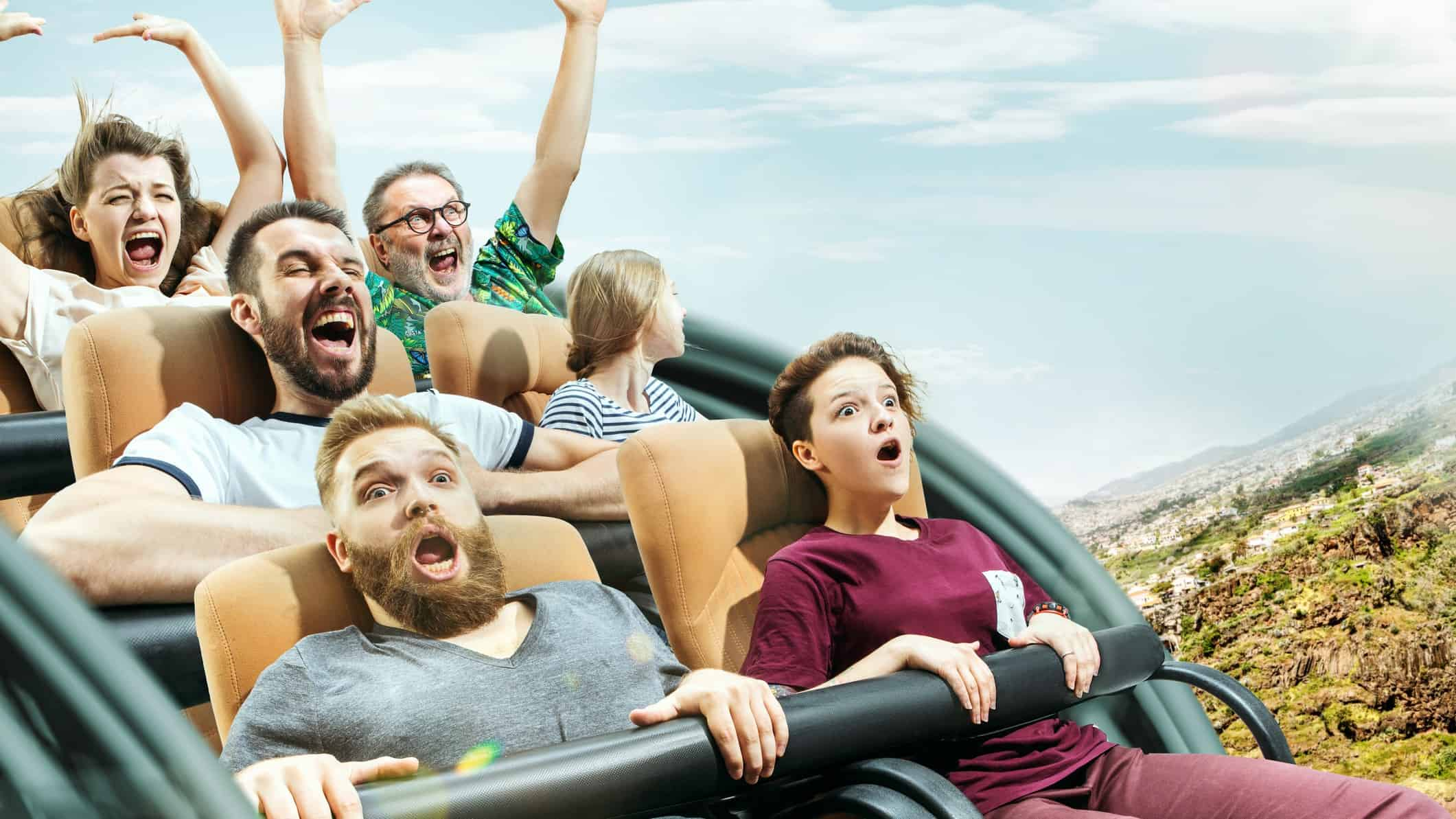volatile as share price represented by scared looking people on roller coaster