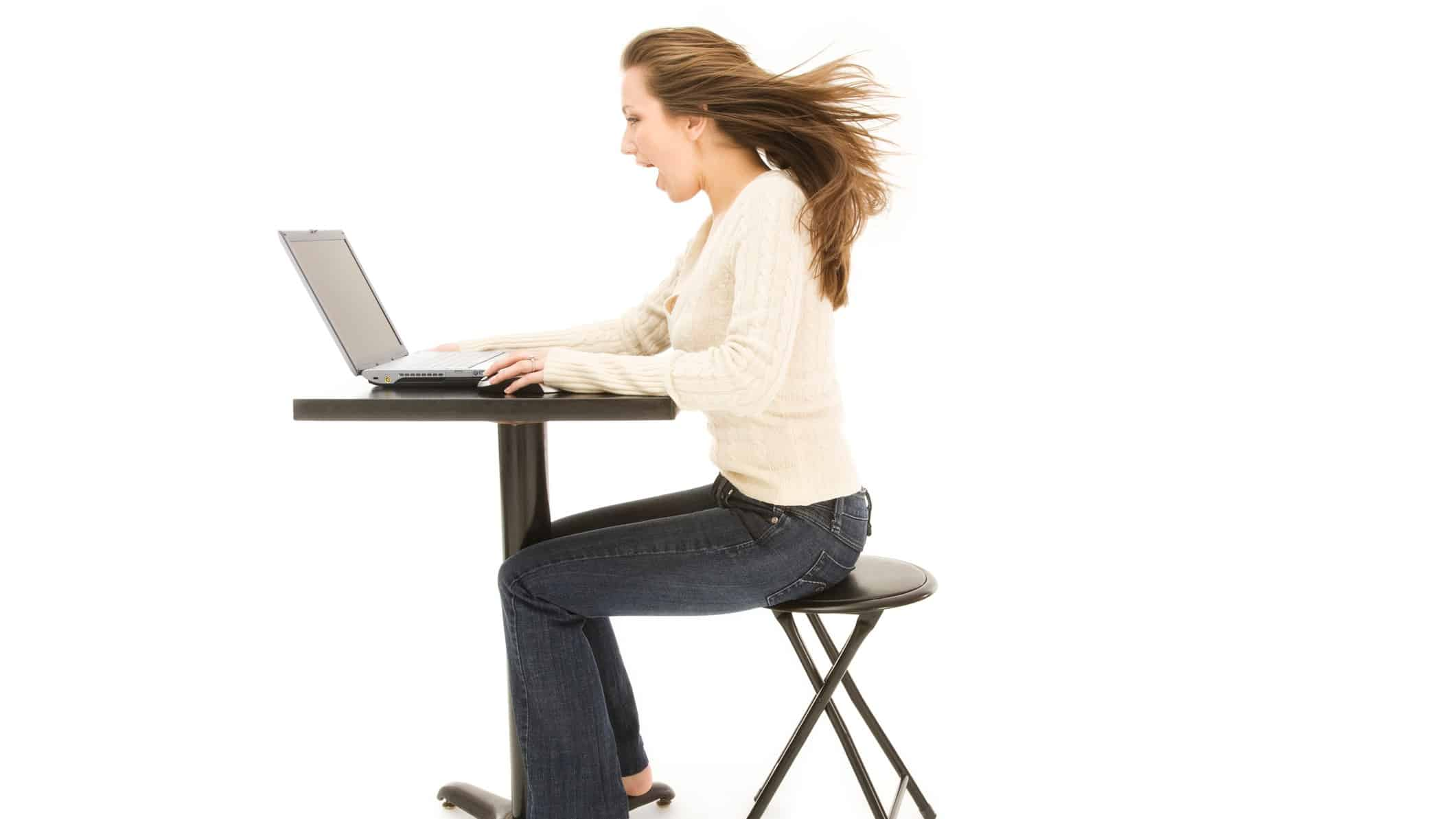 ASX share price rise represented by woman looking excitedly at computer screen
