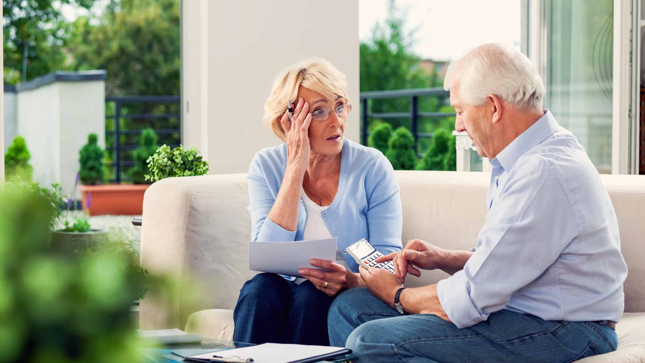 worried couple looking at their retirement savings