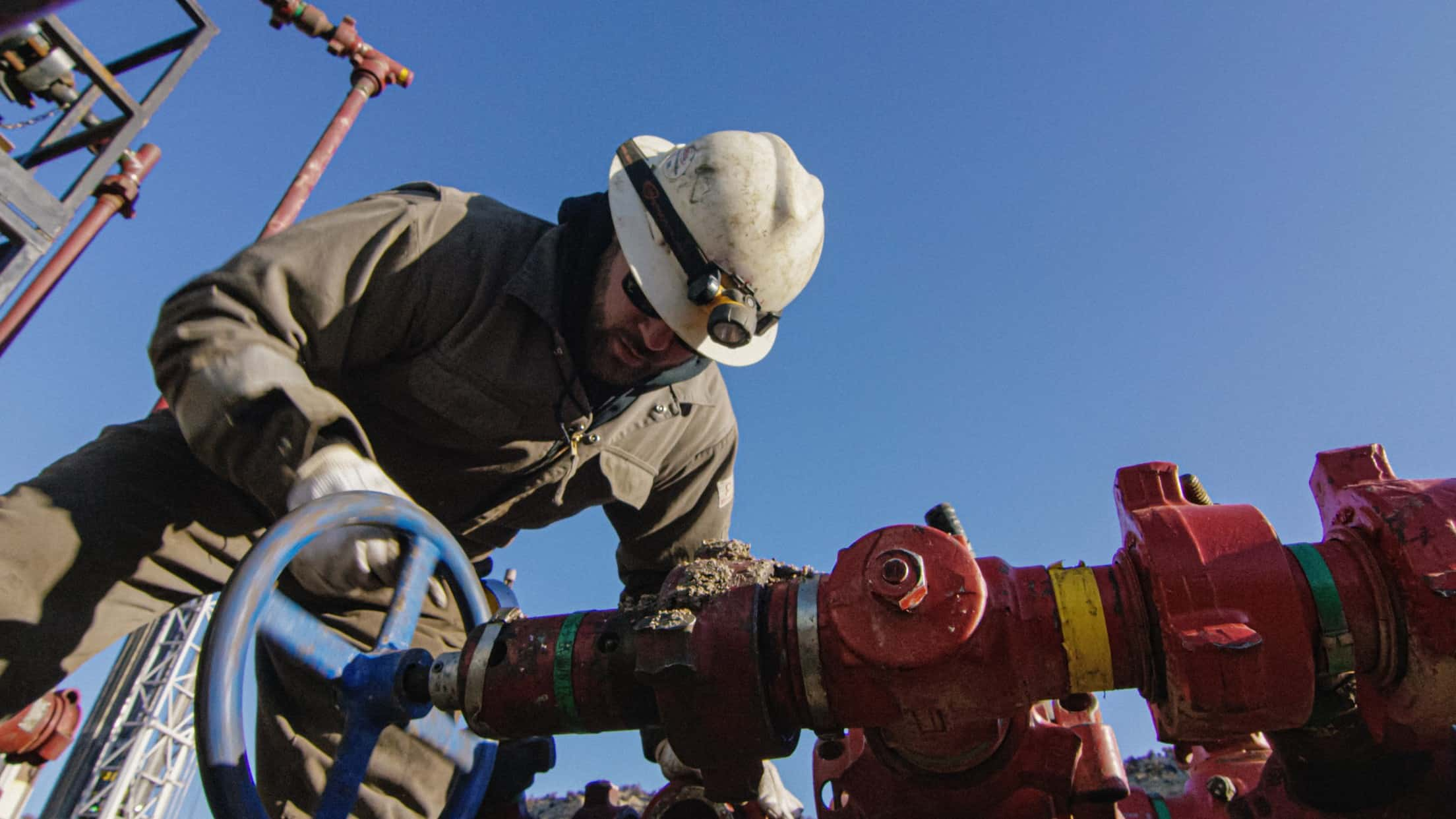gas and oil worker on pipeline equipment