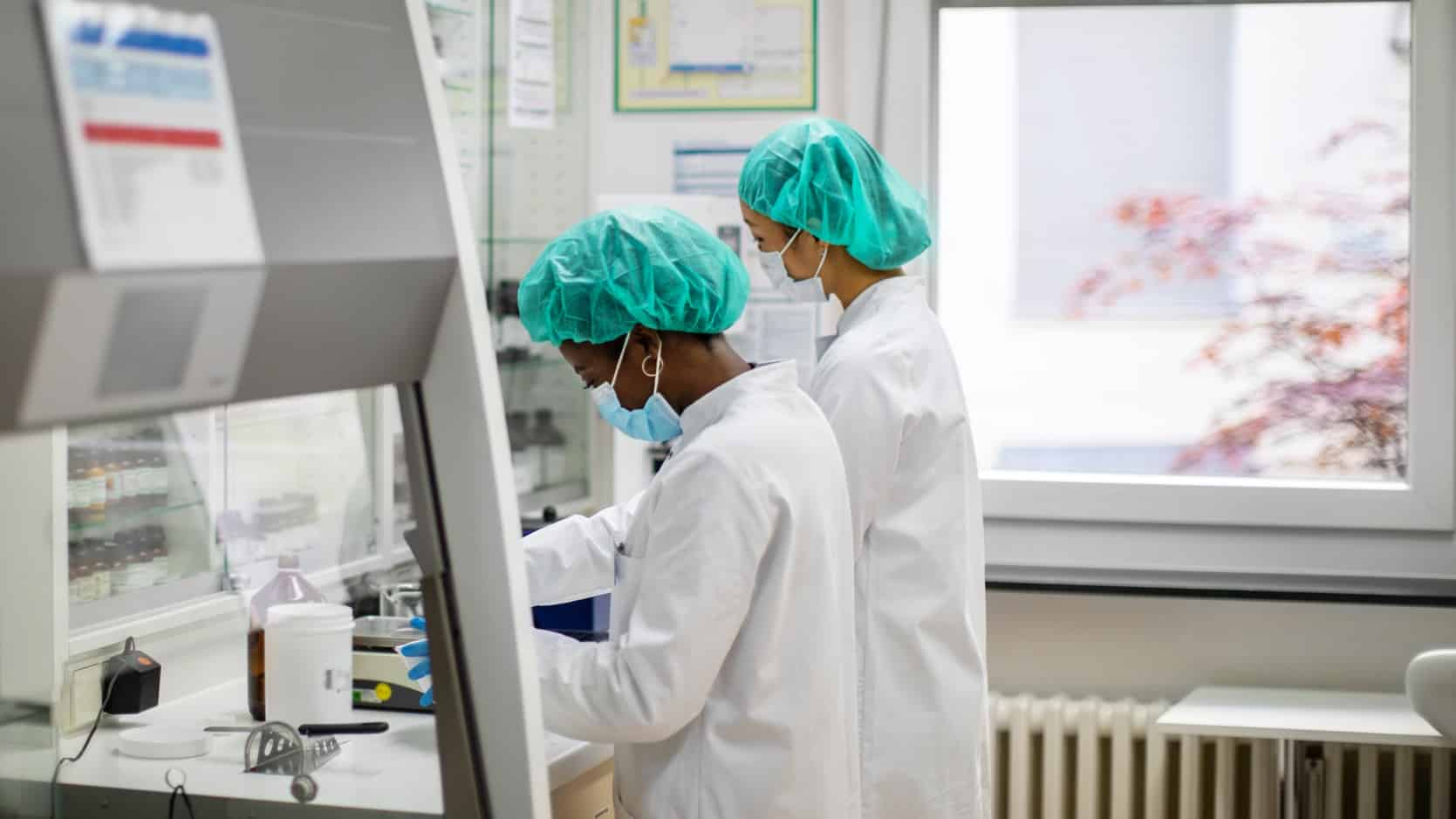 Two lab technicians carrying out clinical trials