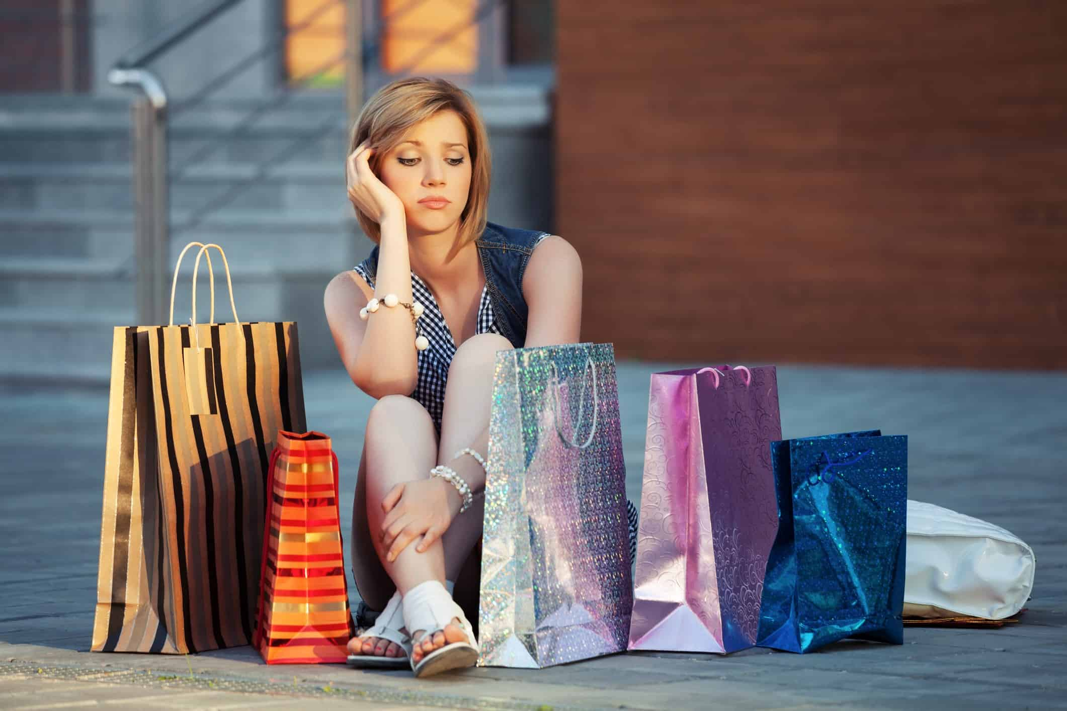 sad person with many shopping bags, buy now pay later