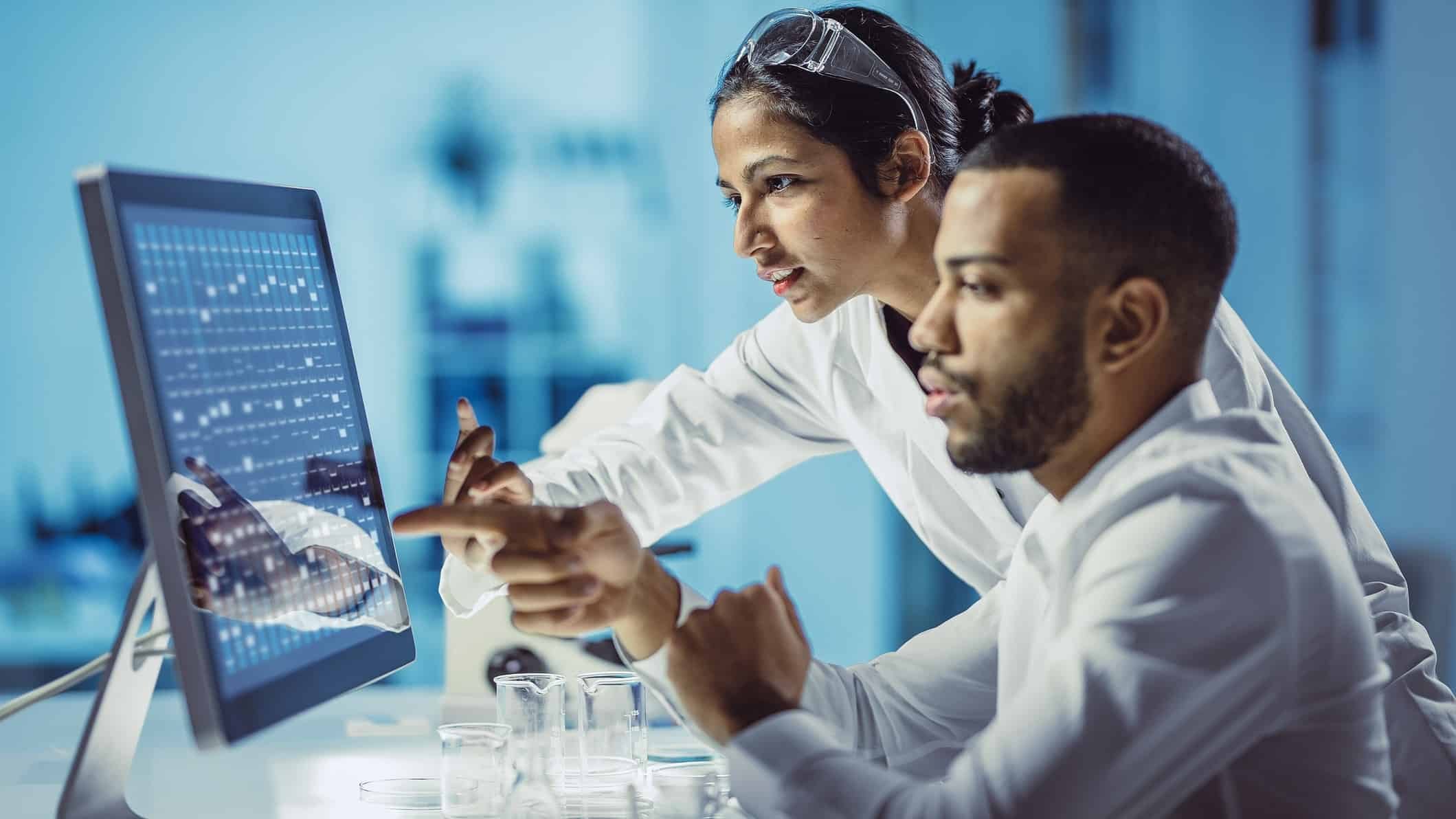 Scientists working on a screen in laboratory