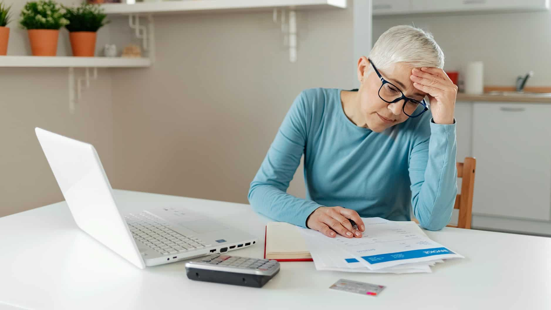 Woman working on laptop making financial decisions