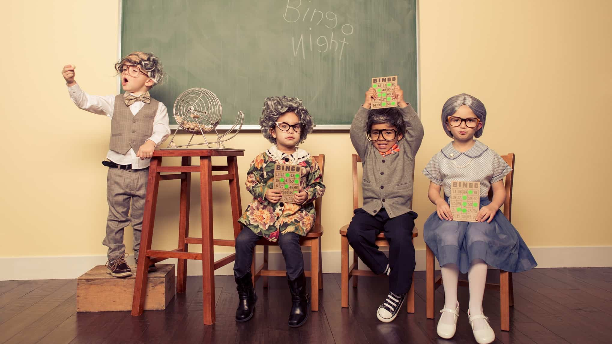 children dressed up in adult clothes at a bingo night with one child winning