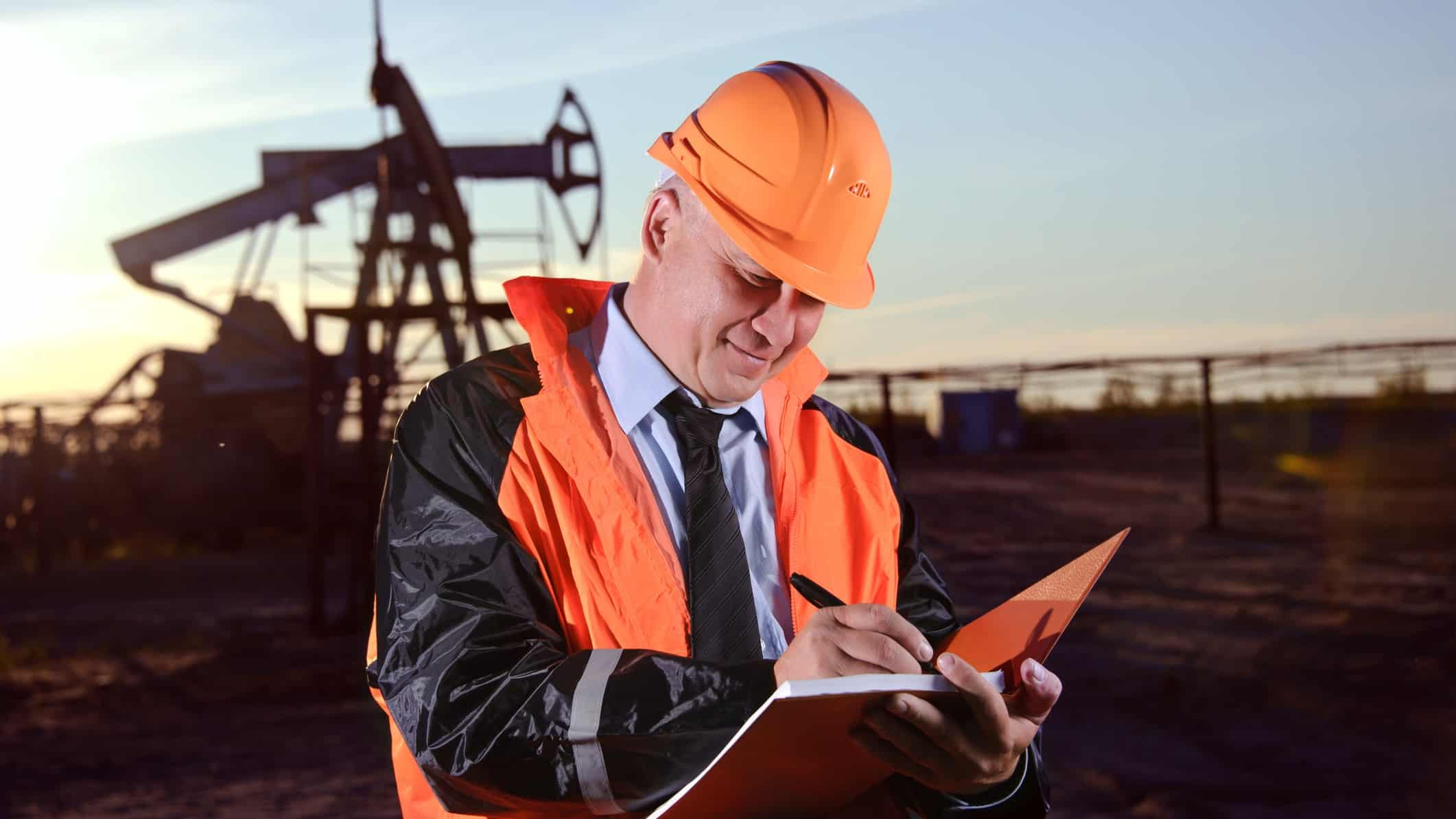 A Woodside worker assesses productivity at an oil rig