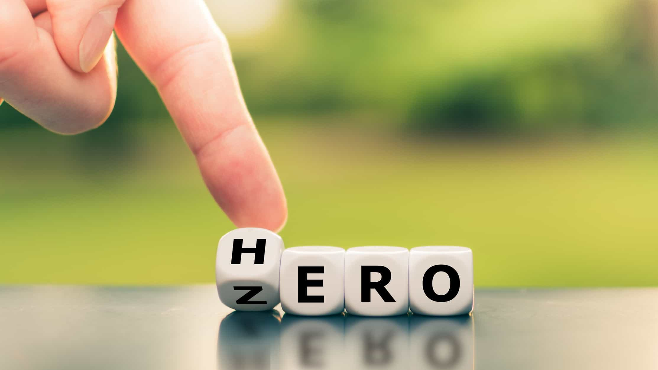 A finger switches the letters on some blocks between zero and hero