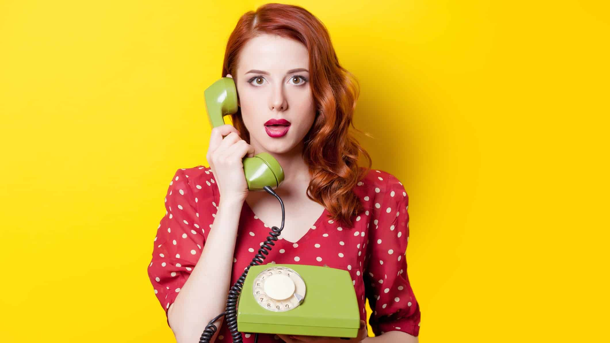 person on old-fashion telephone, surprised person