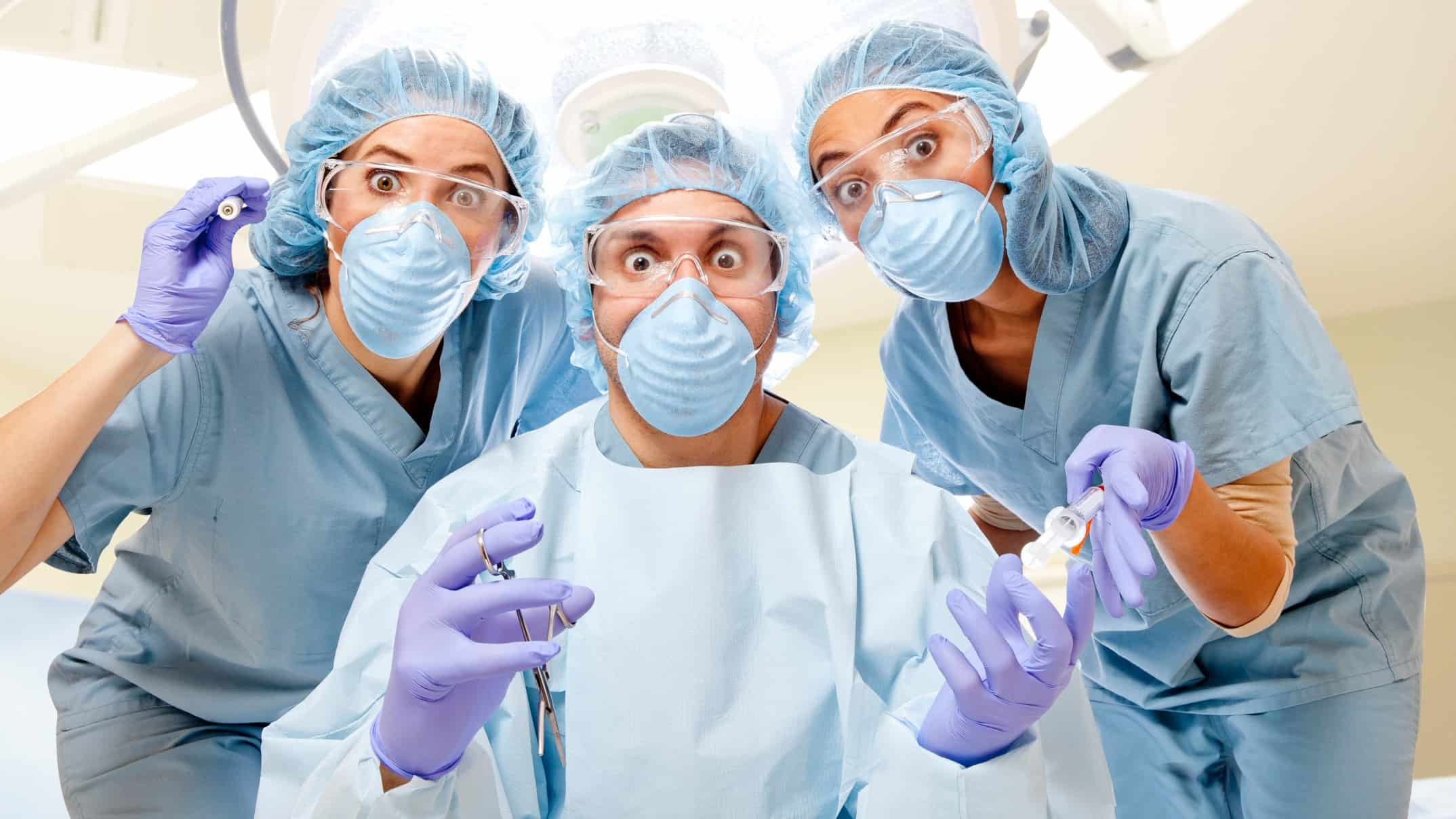 comical medical team wearing masks and scrubs look wide-eyed at the camera, medical shares