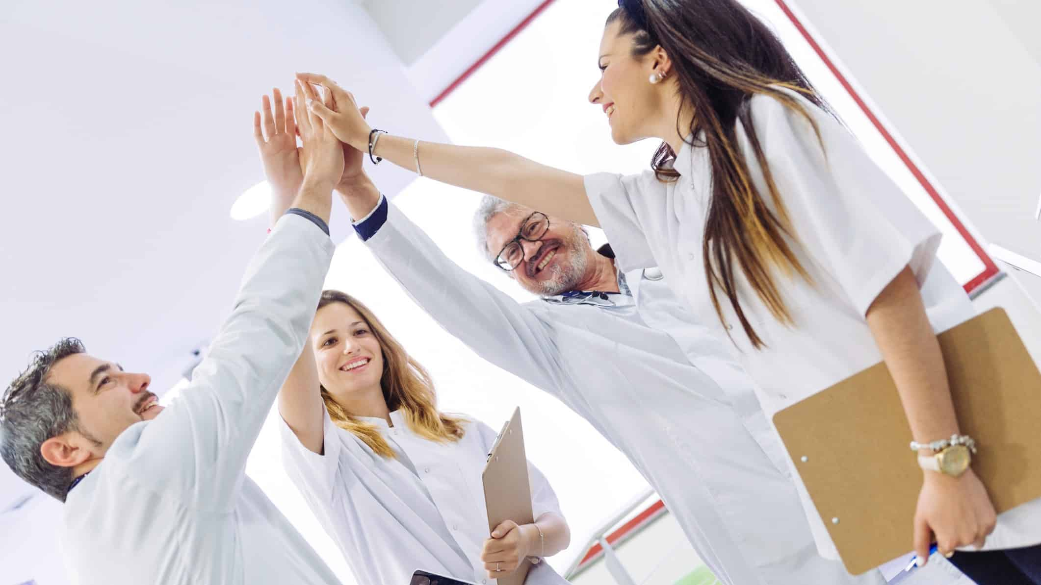 Group of medical professionals high five