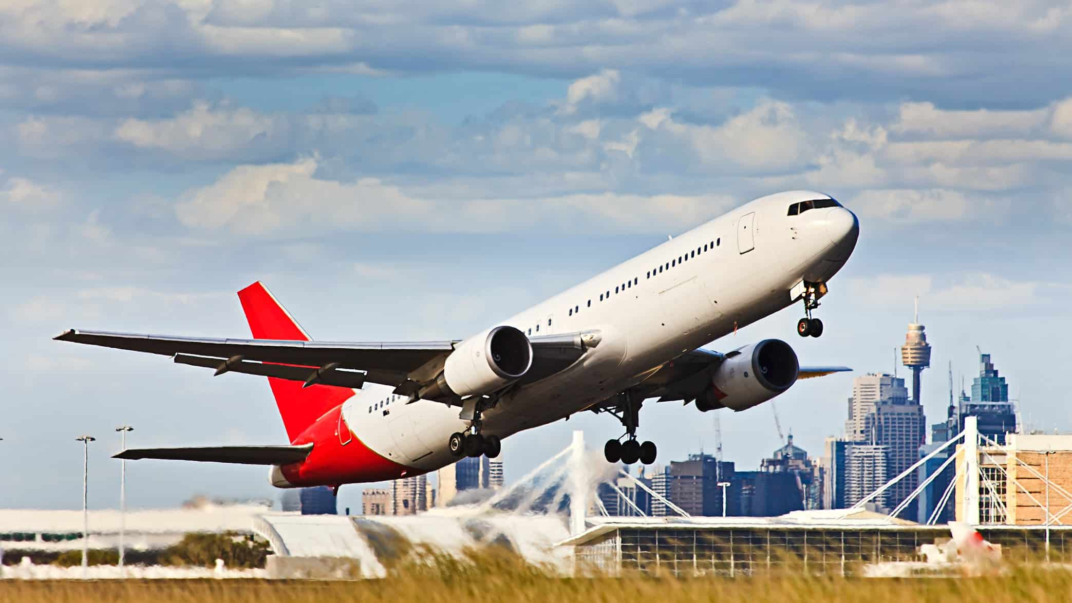 Plane taking off from Sydney airport with CBD in background
