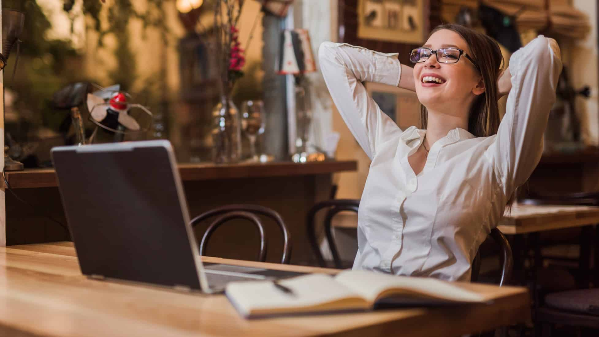 Young woman feeling relieved at laptop