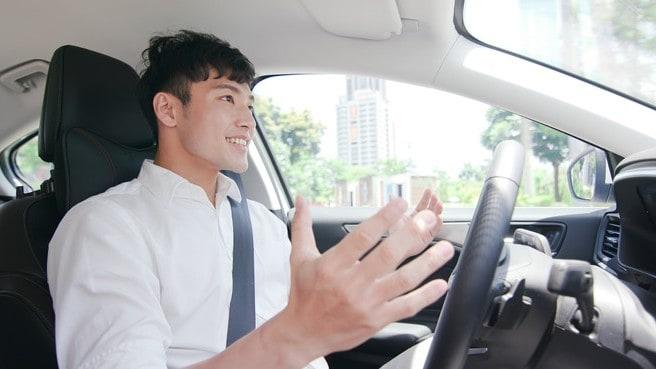 man happy while driving tesla