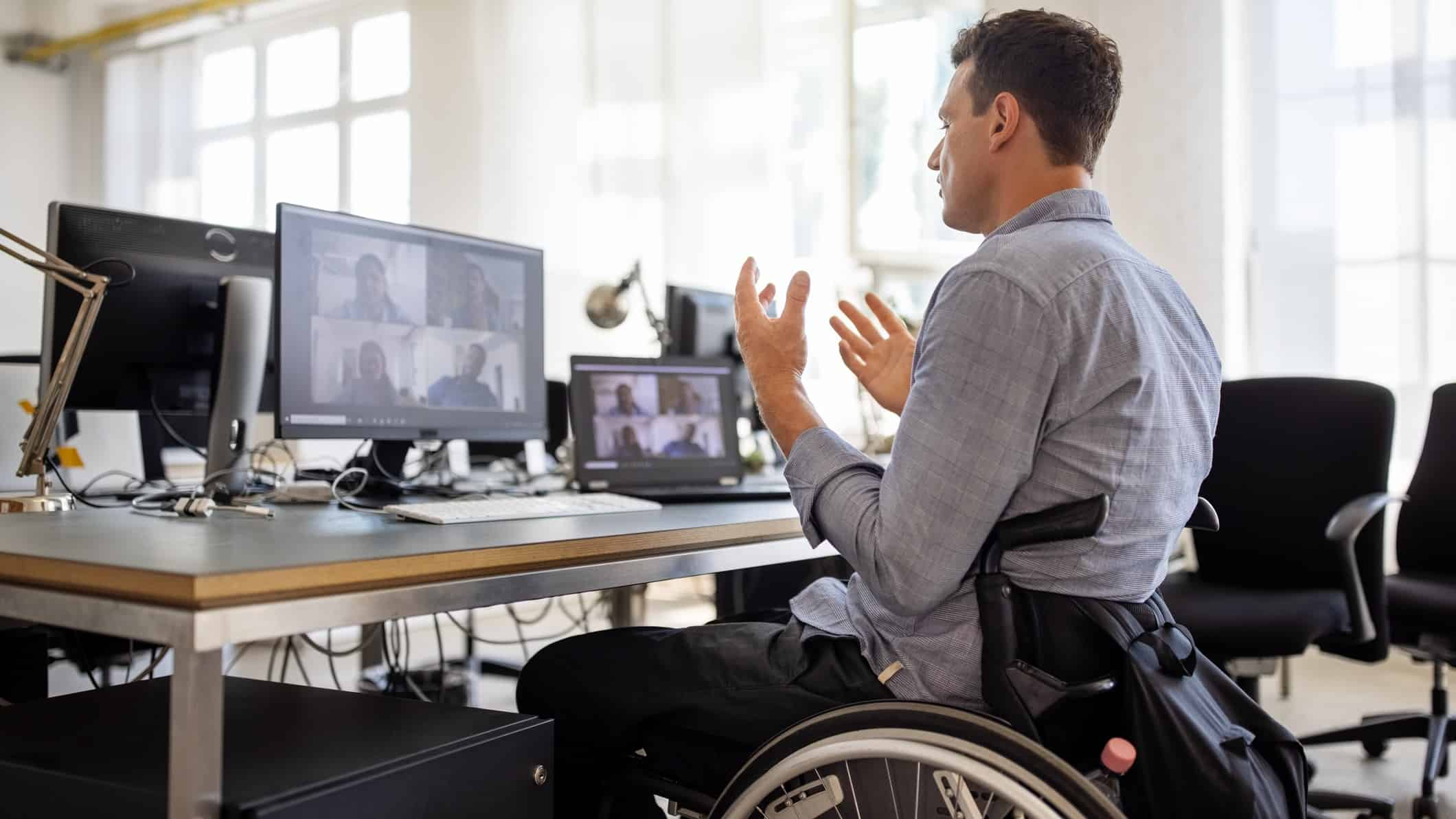 man in wheelchair on zoom call
