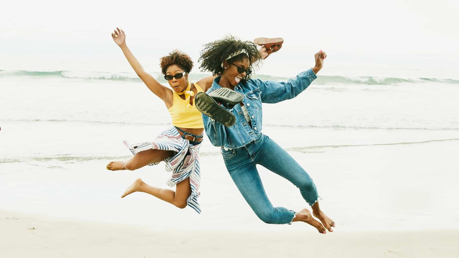 two women jumping into the air