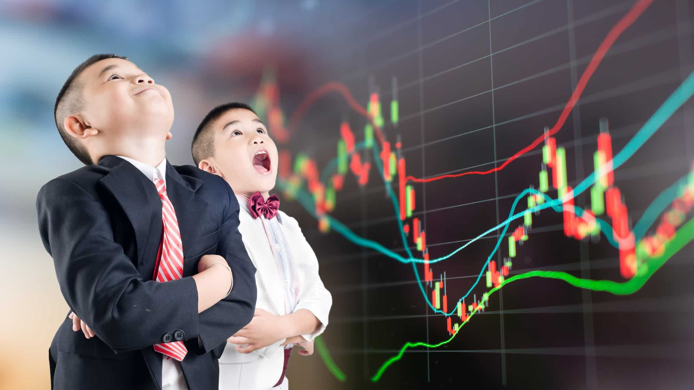 young boys open mouthed in front of shares graph