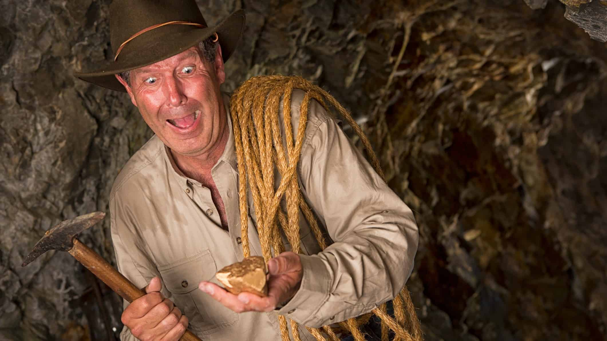 St Barbara share price Minder underground looks excited a he holds a nugget of gold he has discovered.