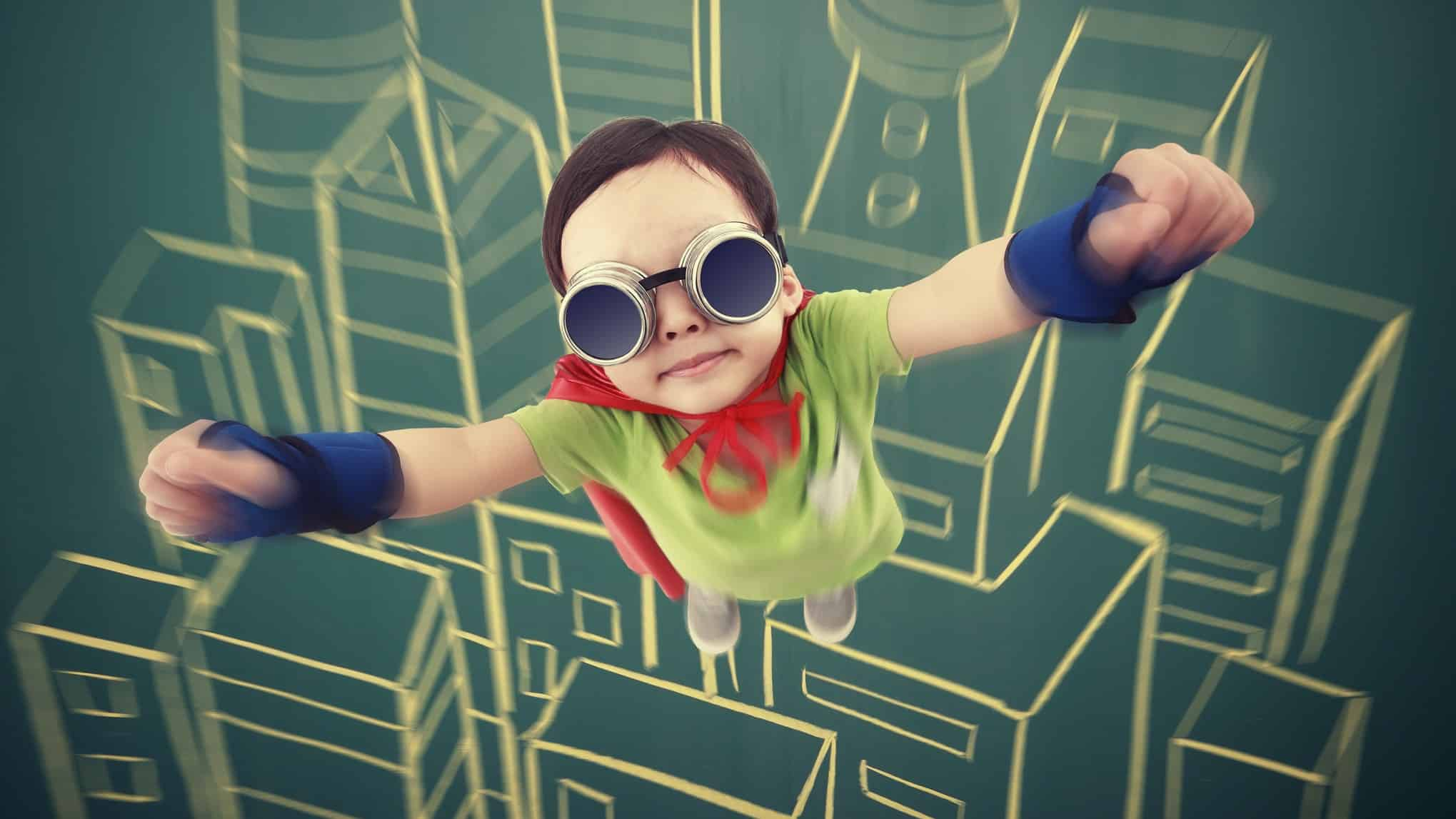 a small boy dressed in a superhero outfit soars into the sky with a graphic backdrop of a cityscape.